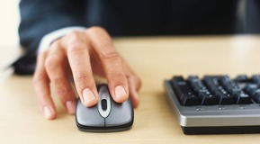 A man using a computer mouse